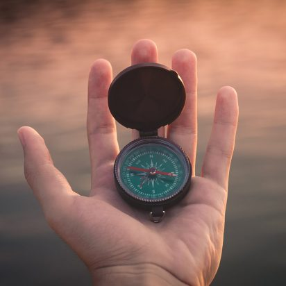 open compass in a hand